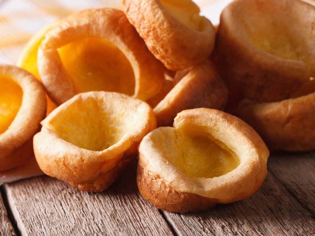 Pile of yorkshire puddings on a wooden table