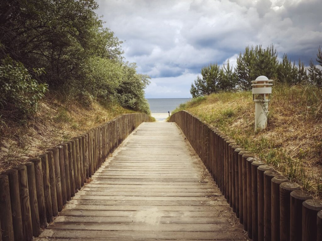 A pathway on Formby Beach during an overcast day.
